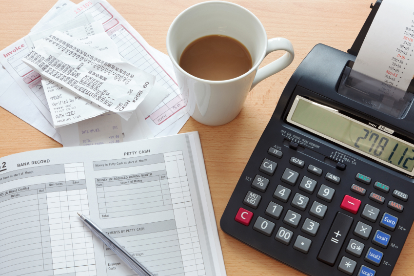 Bookkeeping sales ledger with calculator
