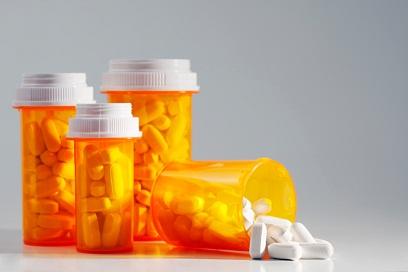 Medicine bottles filled with pills